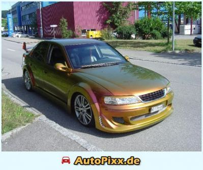 Тюнинг Opel - Опель фото opel_189950.jpg - 573x480